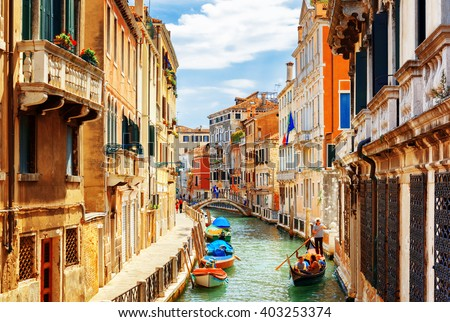 View of the Rio Marin Canal with boats and gondolas from the Ponte de la Bergami in Venice, Italy. Venice is a popular tourist destination of Europe. - stock photo