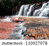 View of the river and the cascade of the waterfalls in Jasper Canyon - Gran Sabana, Venezuela - stock photo