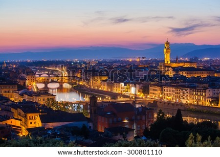 View of the river embankment of Arno and cathedrals of Florence from Michelangelo's hill on a sunset