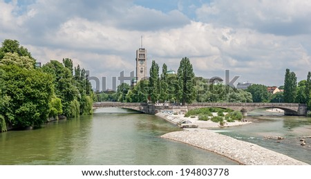 """View of the river """"Isar"""" and the historic museum of Munich in Bavaria - stock photo"""