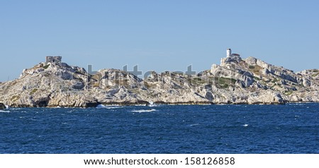 """View of the rocky island """"Frioul"""" and its old castle buildings near Marseille in South France - stock photo"""