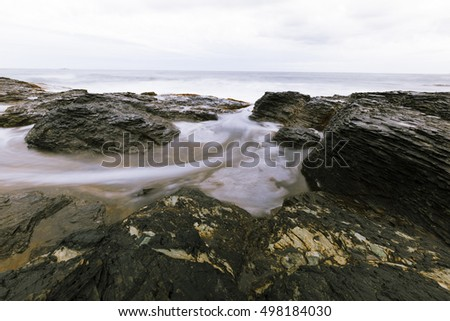 View of the rocky ocean shore