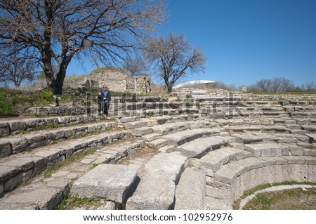 View of the Roman Amphitheatre of the ancient city of Troy (3000BC - 1BC) with ruins of twelve cities built on top of each other (Troy I to Troy XII), in Anatolia, Turkey.