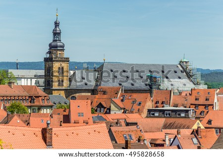 View of the roofs and St. Martin Church in Bamberg city in Bavaria, Germany. The city is under the UNESCO protection.