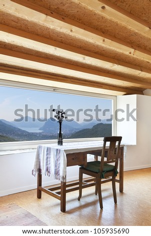 view of the room, rural home interior, picture window