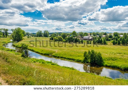 View of the rural landscape and the river a sunny summer day