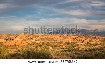 View of the sand dunes in Arches National Park during sunset hour.