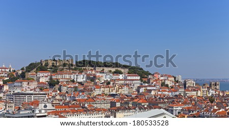 View of the Sao Jorge Castle, the historical Baixa (downtown), Alfama and Mouraria Districts of Lisbon, Portugal. - stock photo
