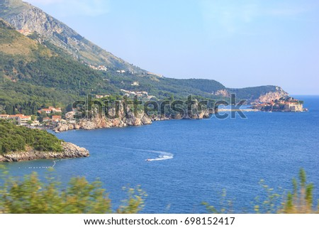 View of the sea bays, the Przno city and the island of Sveti Stefan in Montenegro from the bus passing along the seacoast