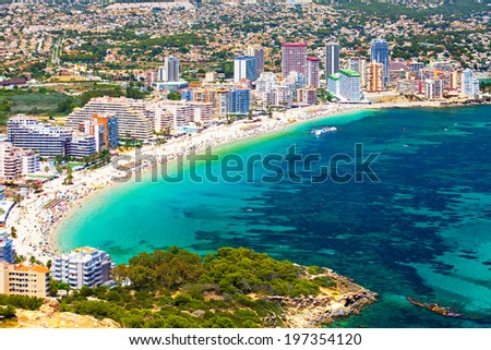 View of the sea coast with people on city background (Costa Brava, Spain Coast) - stock photo
