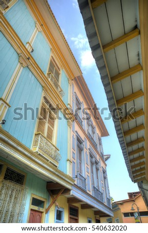 View of the second floor of some old houses and its windows, in Las Peñas neighborhood, Guayaquil, Ecuador
