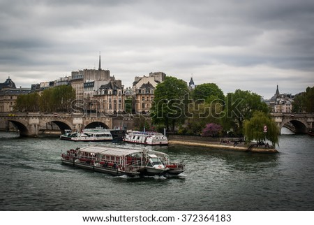 View of the Seine river from a bridge in Paris, France