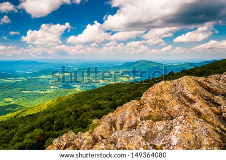 View of the Shenandoah Valley from cliffs on South Marshall, in Shenandoah National Park, Virginia. - stock photo