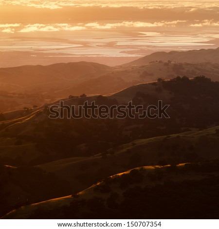 View of the Silicon Valley at sunset from Mount Hamilton. - stock photo