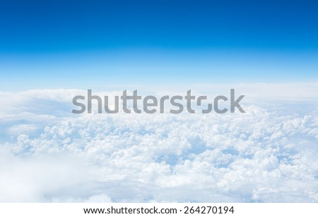 View of the sky and clouds from the airplane porthole - stock photo