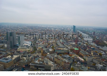 View of the skyline of frankfurt taken from top of the main tower during cloudy day in november. - stock photo