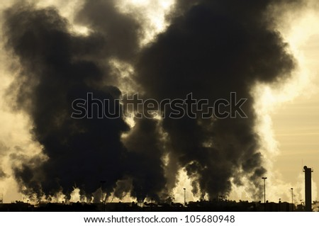 view of the smoke produced by a polluting industry in Saragossa, Aragon, Spain - stock photo