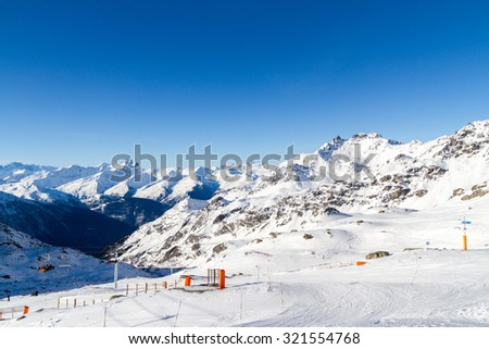 view of the snow-capped mountains , ski slopes , ski lifts, Val Thorens,  France - stock photo