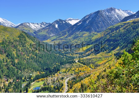 view of the snow covered Mt Sopris during foliage season in Colorado