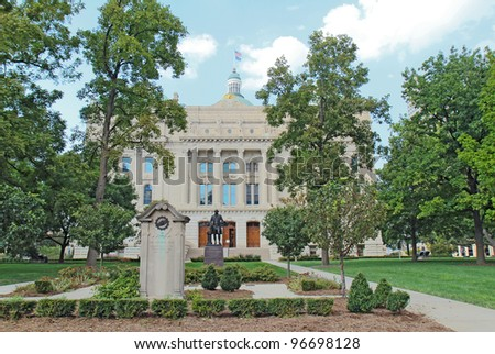 View of the south entrance to the Indiana State Capitol building in downtown Indianapolis showing monuments to the National Road and George Washington - stock photo