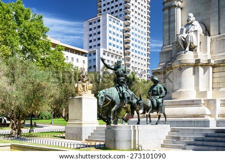 View of the stone sculpture of Miguel de Cervantes and bronze sculptures of Don Quixote and Sancho Panza on the Square of Spain (Plaza de Espana). Madrid is a popular tourist destination of Europe. - stock photo