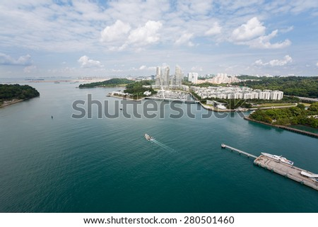 View of the strait separating the island of Sentosa and Singapore with bird's-eye view. - stock photo