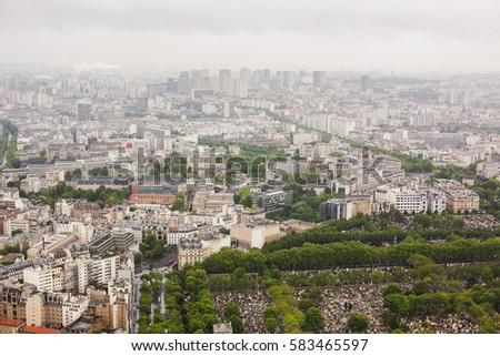 View of the streets of Paris from the heights. Travel through Europe. Attractions in France. Cloudy Paris. Clouds in the sky.