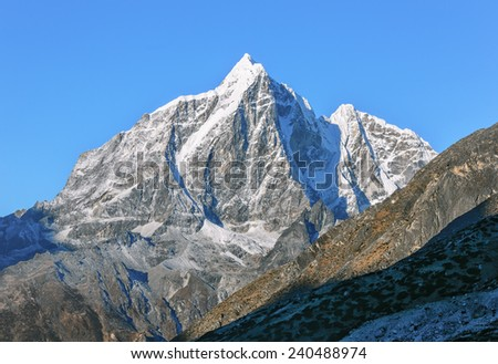 View of the Taboche peak (6367 m) from the village of Dingboche in the valley Chhukhung - Nepal, Himalayas - stock photo