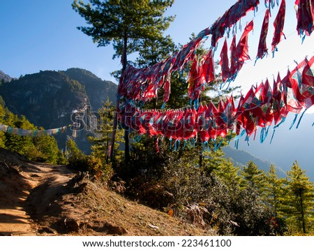 View of the Taktshang monastery in Paro (Bhutan) with prayer flags (focus on monastery) - stock photo