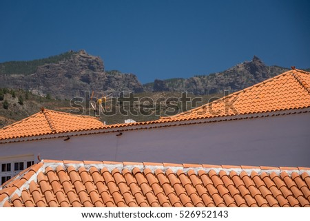 View of the tiled roofs oh homes in a small town of Fataga in Gran Canaria, Canary Islands, Spain