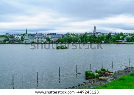 View of the Tjornin (the pond), with the Frikirkjan and Hallgrimskirkja churches, in Reykjavik, Iceland