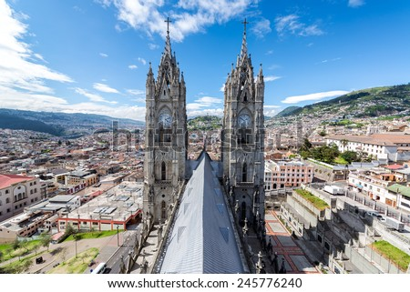 View of the towers of the Basilica in Quito, Ecuador with the city visible in the background - stock photo