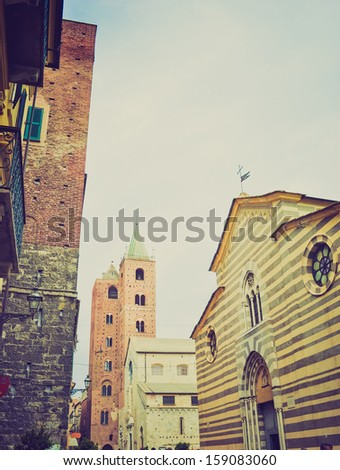 View of the town of Albenga, Genoa, Italy vintage look
