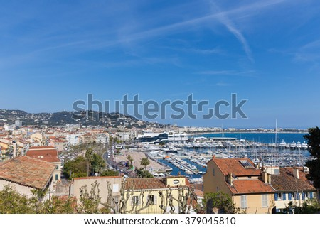 View of the town of Cannes and its harbour - stock photo