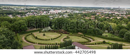 "View of the town of Chelm in eastern Poland. In the foreground, a garden with a living rosary in the park next to the Basilica of the Virgin Mary ""on the hill"" - stock photo"