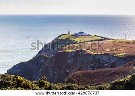 View of the trails on Howth Cliffs and Howth Head with the Baily Lighthouse and the Irish sea in the background in Ireland