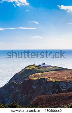 View of the trails on Howth Cliffs and Howth Head with the lighthouse in Ireland - stock photo
