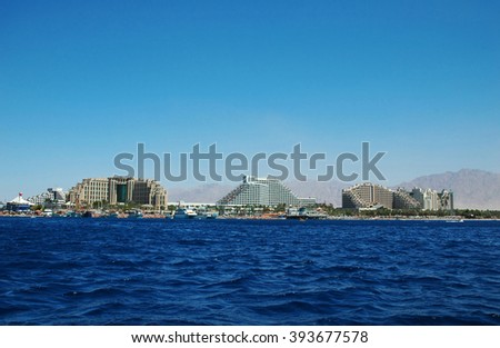 View of the tropical beach of Eilat with its luxury hotels on a  - stock photo