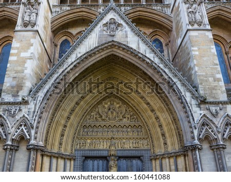 View of the trumeau and archivolts on the side entrance to Westminster Abbey in London, England - stock photo