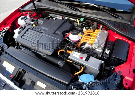 View of the two engines of a modern hybrid car.  Hybrid car engine.  - stock photo