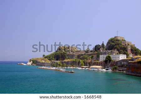 view of the unique Old Fortress and the marina below at magical Corfu island Greece - stock photo