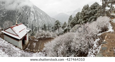 View of the valley from Tengboche monastery after a night of snowfall - Nepal, Himalayas - stock photo
