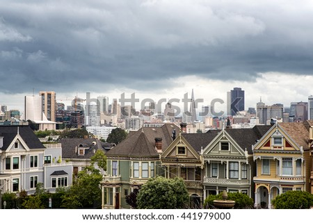 View of the victorian Painted Ladies buildings, with the skyline of San Francisco in the background. - stock photo