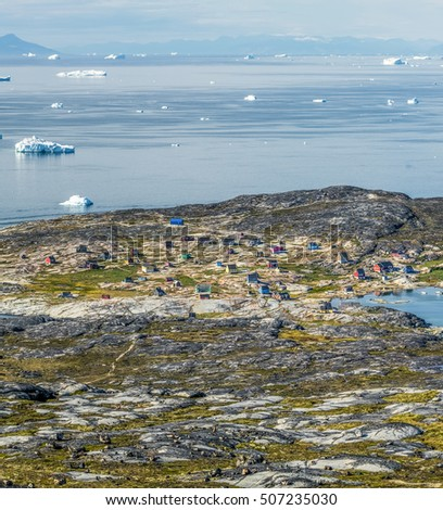 View of the village Oqaatsut summer night. Rodebay mont on background - Greenland