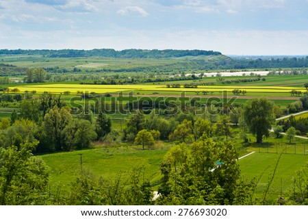 View of the Vistula river valley with flowering oilseed rape fields in the area of Janowiec, Poland