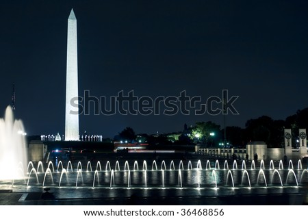 View of the Washington Monument and Capitol in DC at night