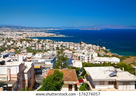 view of the white houses of beautiful Chania city from above, its Crete, Greece
