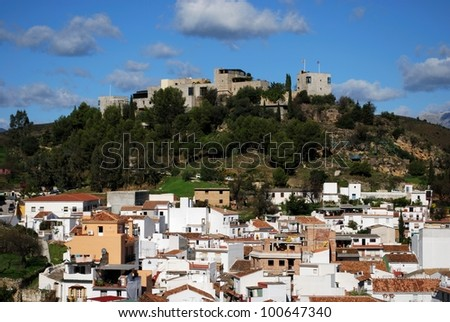 View of the whitewashed village with the castle to thr rear, Monda, Costa del Sol, Malaga Province, Andalusia, Spain, Western Europe. - stock photo