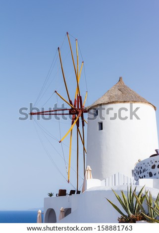 View of the windmill against a blue sky in Oia, Santorini, Greece