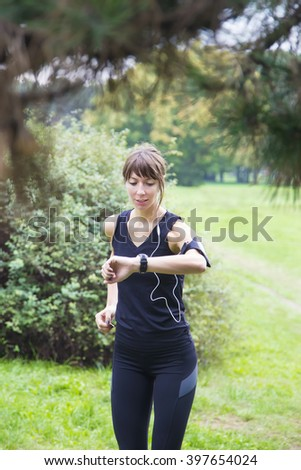 View of the woman running in the park